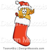 Stock Mascot Cartoon of a Golden Police Badge Mascot Cartoon Character Wearing a Santa Hat Inside a Red Christmas Stocking by Toons4Biz