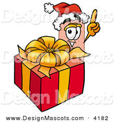 Stock Mascot Cartoon of a Smiling Bandaid Bandage Mascot Cartoon Character Standing by a Christmas Present by Toons4Biz