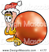 Stock Mascot Cartoon of a Smiling Bandaid Bandage Mascot Cartoon Character Wearing a Santa Hat, Standing with a Christmas Bauble by Toons4Biz